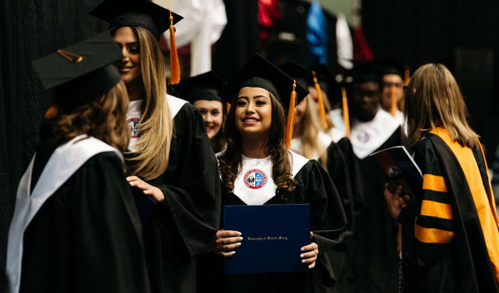 Students lining up for diplomas from Commencement 2018