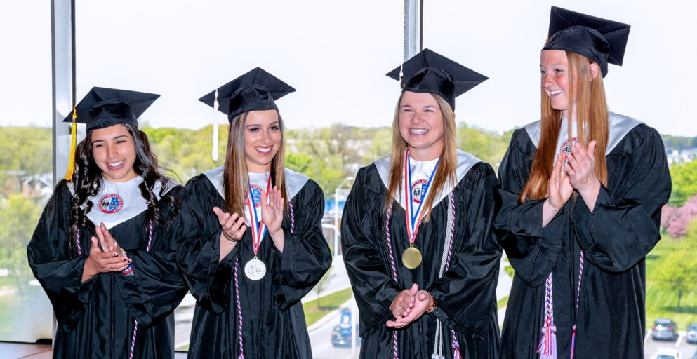 From left, Jordan Manno, Sydney Pollock, Courtney Gilbert and Ashley Mauser had a special graduation on Tuesday because they were out of state in a softball tournament during Saturday's scheduled commencement.
