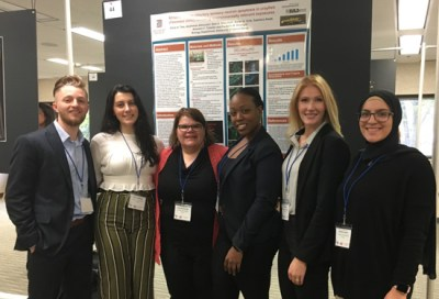Students presenting their research at a conference.