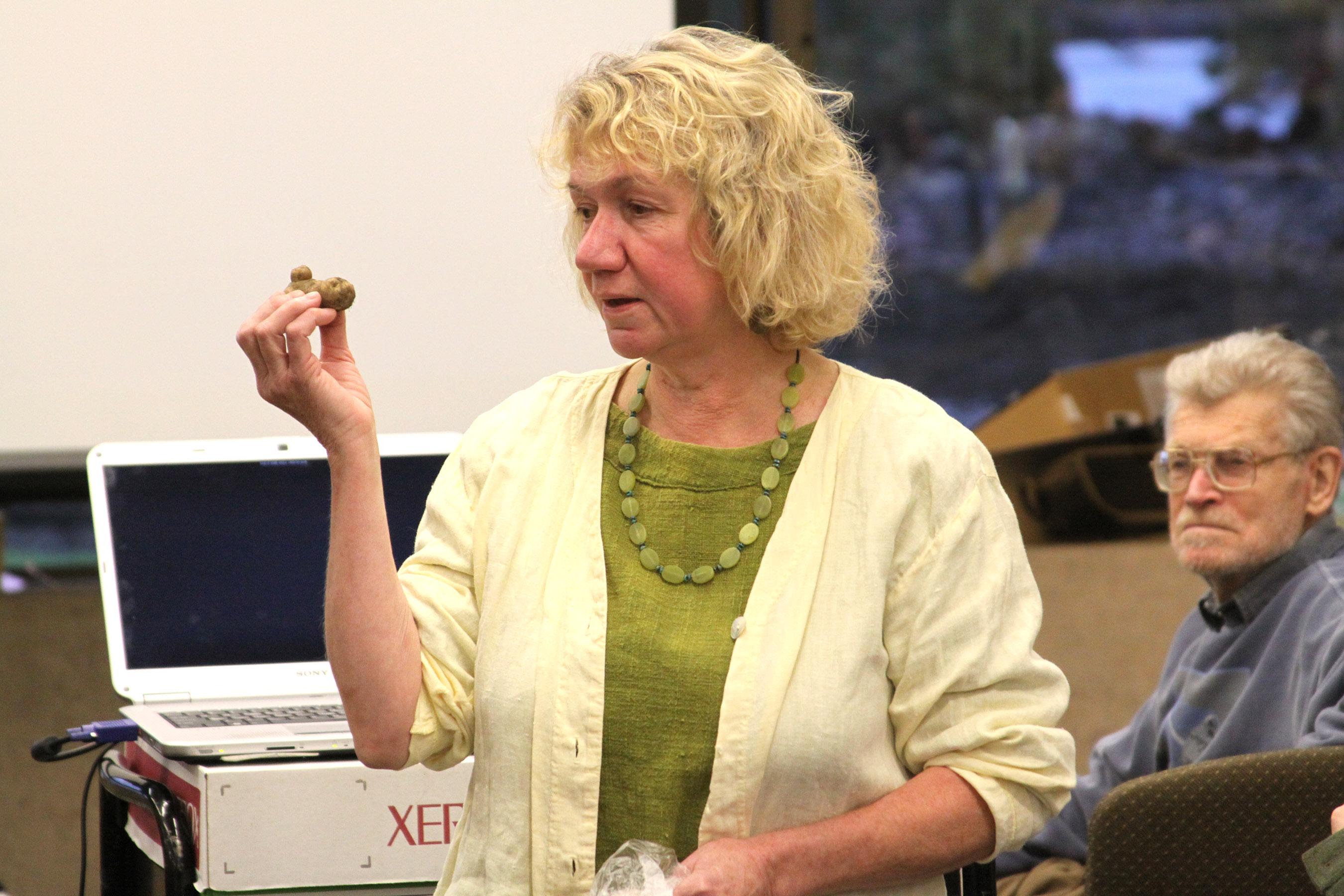 "Elizabeth Kunibe shows off a Tlingít potato (also known as ""Maria's potato"")"