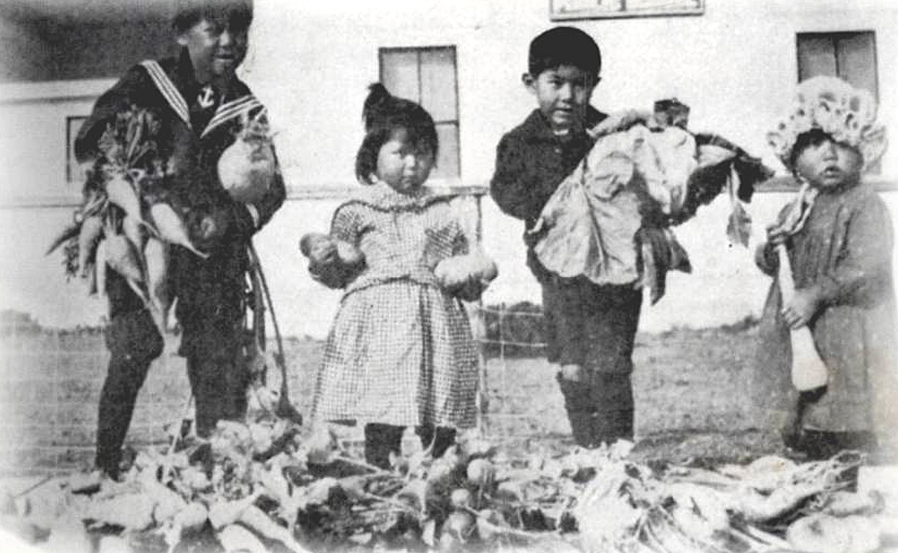Children show off the bounty from the Klukwan School garden in 1911
