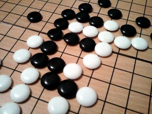Snapshot of a Go game in progress [Image: 'Go Board Game' from Sean Welton under a CC BY-NC-SA 2.0 licence]