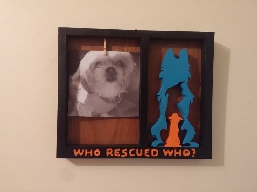 Wooden frame featuring SWM logo cut from wood