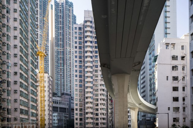 14 Jan 2015, Victoria, Hong Kong Island, Hong Kong, China --- China, Hong Kong, Highway overpass and surrounding high rise apartment towers in Kennedy Town district on winter afternoon --- Image by © Paul Souders/Corbis