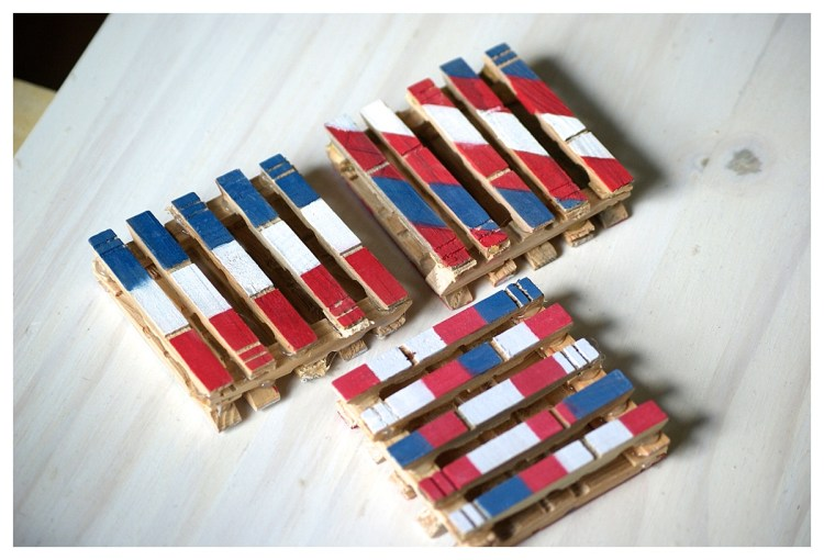 DIY Pallet Coasters | Pallet Tutorial Coasters | Patriotic Red White Blue Decor | Summer Party Patio Deck | Six Clever Sisters | Make these cute mini pallet coasters with just some clothespins, glue, and paint!