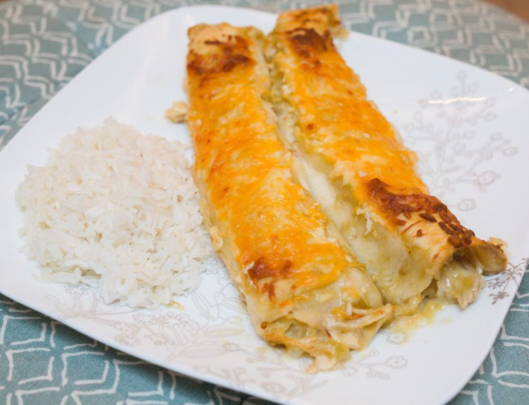Easy Chicken Enchiladas | Green Chile Enchiladas | Chicken Enchilada Recipe | The Best Chicken Enchiladas | Mmmm - you'll love these Green Chile Chicken Enchiladas that only use 6 ingredients! This is also a great meal to put together and keep in your freezer :-) Find the recipe at SixCleverSisters!