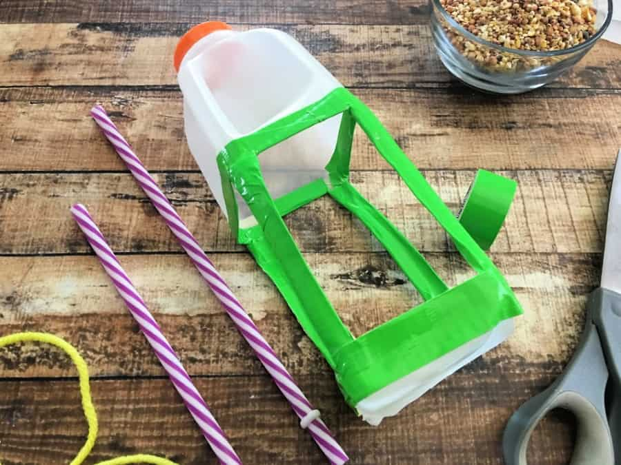Looking for a way to repurpose milk jugs? Make this milk jug bird feeder! This upcycled craft is easy to make and sure to attract beautiful birds looking for a snack!