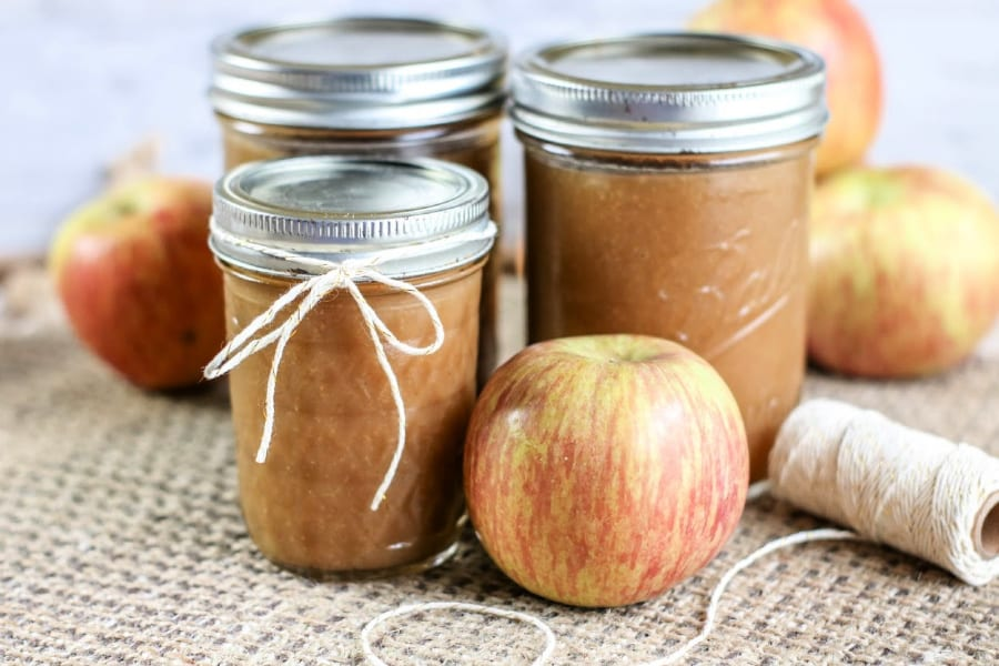 This Instant Pot apple butter is the taste of fall in a jar! Eat it fresh or use this Instant Pot apple butter for canning! Click for the recipe.