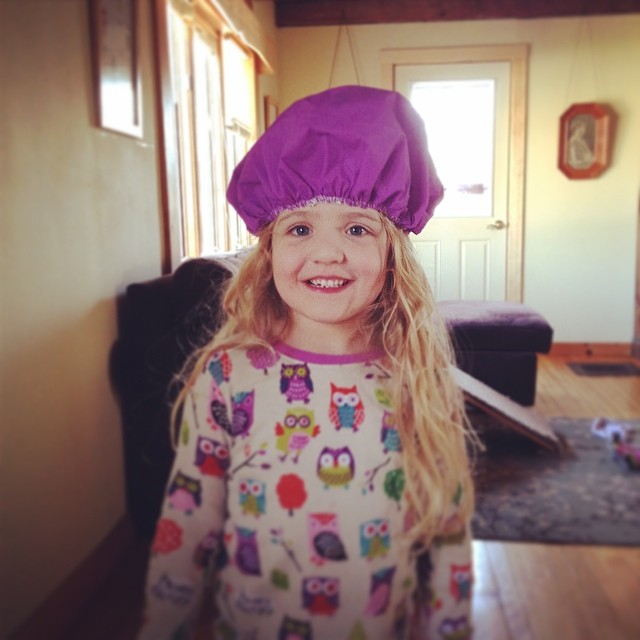 She found Gramma's shower cap :)