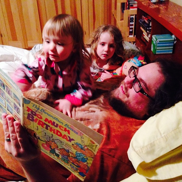 Reading with Daddy before bed