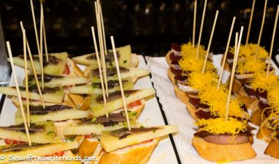 Two Types of Pintxo. The one on the Left is A Manchego Cheese and Anchovy and the Other is a Mixture of Meat and Cheese