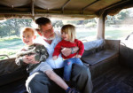 Kaj and grandkids in the Pinzgauer