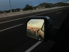 Sunset of in the rearview mirror