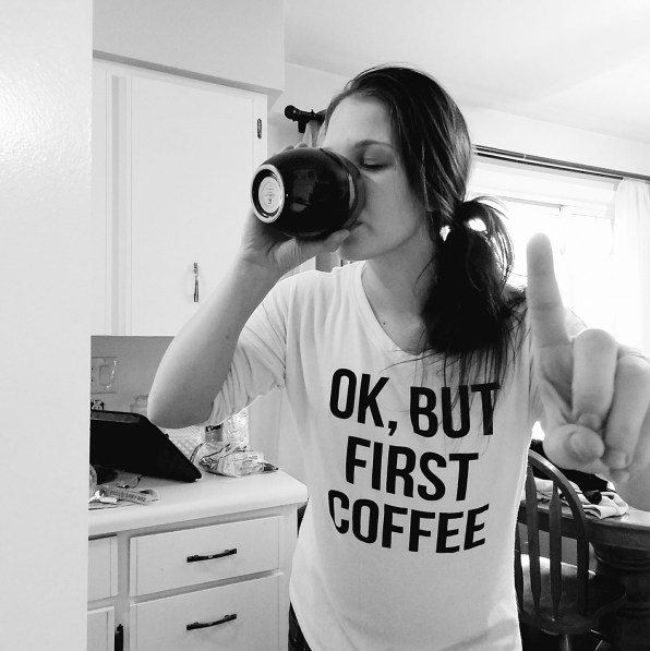 "Wearing an, ""Ok, but first coffee"" shirt while holding up a ""one minute"" figure as I chug some coffee."