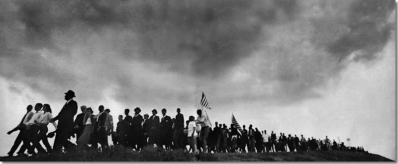 Marchers from Selma to Montgomery carried the U.S. flag; you should fly yours today in honor of Martin Luther King, Jr. Image from 60s Survivors page on Joanna Bland, who was part of the march.