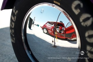 The Cooper reflected in another racer's wheel during tech inspection. Photo by Mike Wilson ©2012. All Rights Reserved.