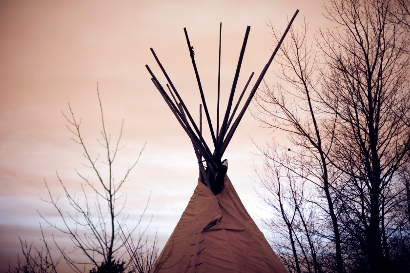 Tied seven times on top, each time represents the seven fires; the opening of the tipi always faces the East (sunrise). Photo credit: Natalie Escobedo