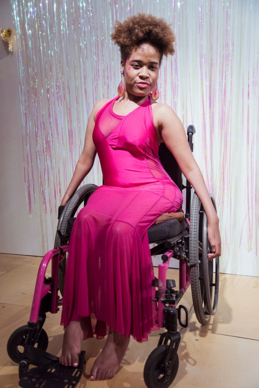 Dee Rae Glass rocks a hot pink dress that matches her wheelchair, while stylishly going barefoot. Photo credit Kiam Marcelo Junio.