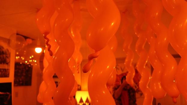 Spiralling orange balloons. Photo credit: Ryan Paluczak.