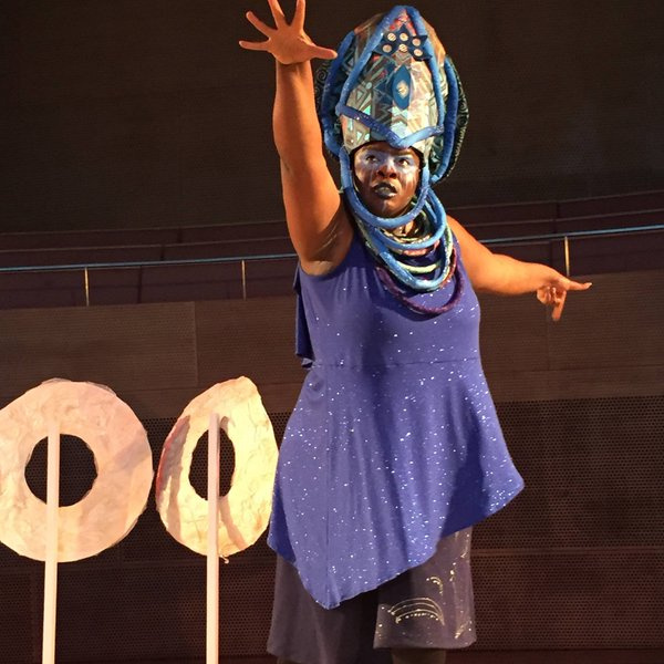 "Image from ""Ma(s)king Her"" by Honey Pot Performance at Pritzker Pavilion, Millennium Park, Chicago, April 14–16, 2016 . Featuring ""Oracle"" sculptures and Abra Johnson as Wonder in headdress, both designed by D. Denenge Akpem (featuring textile by Euzhan Sims and costume by Jane Bagnall). Image credit: Lani Montreal."