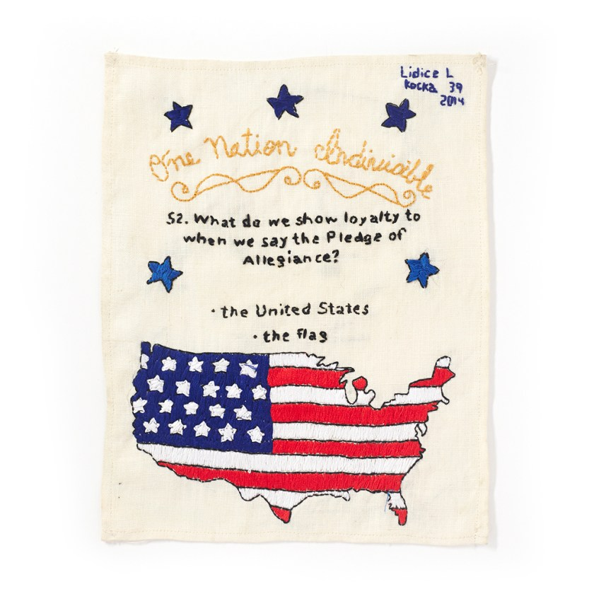 """US Citizenship Test Sampler"" #52 Made by Lidice L., 2013–present. Embroidered sampler with the question and answer: ""52. What do we show loyalty to when we say the Pledge of Alligence? The United States, the flag"" stitched alongside the flag in the shape of the map of the U.S. Photo by Jayson Cheung."