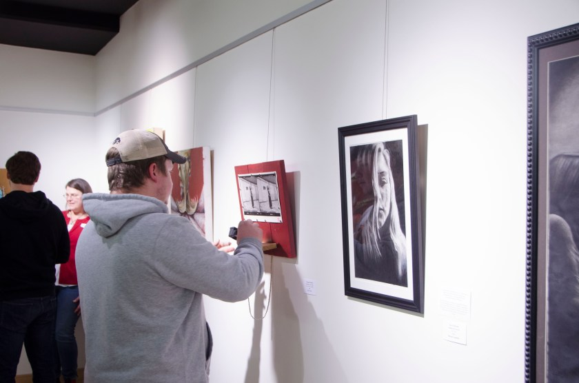 "A shot from ""Piece Of Mind"" showing a guest interacting with EAC member Brian Rowe's Piece ""Pregnant Dreams"""
