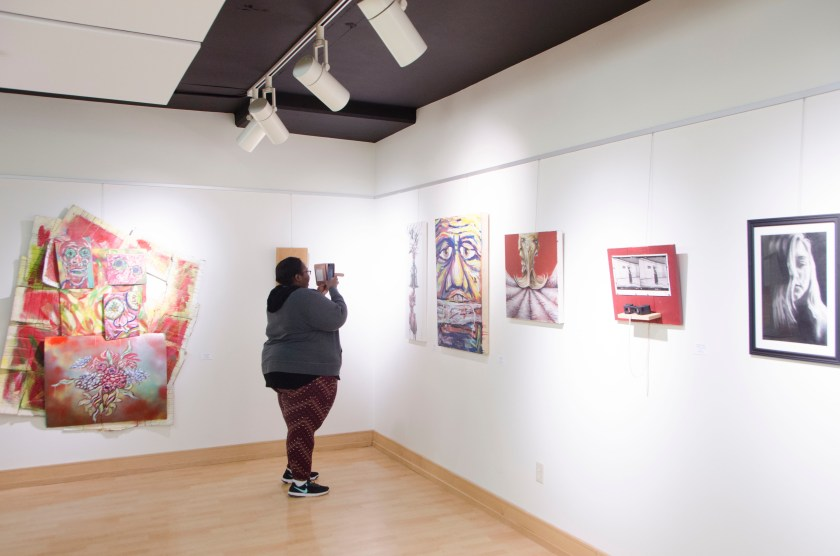 "Guest is shown taking photos of work in ""Piece of Mind"" Photo by Alexander Martin"