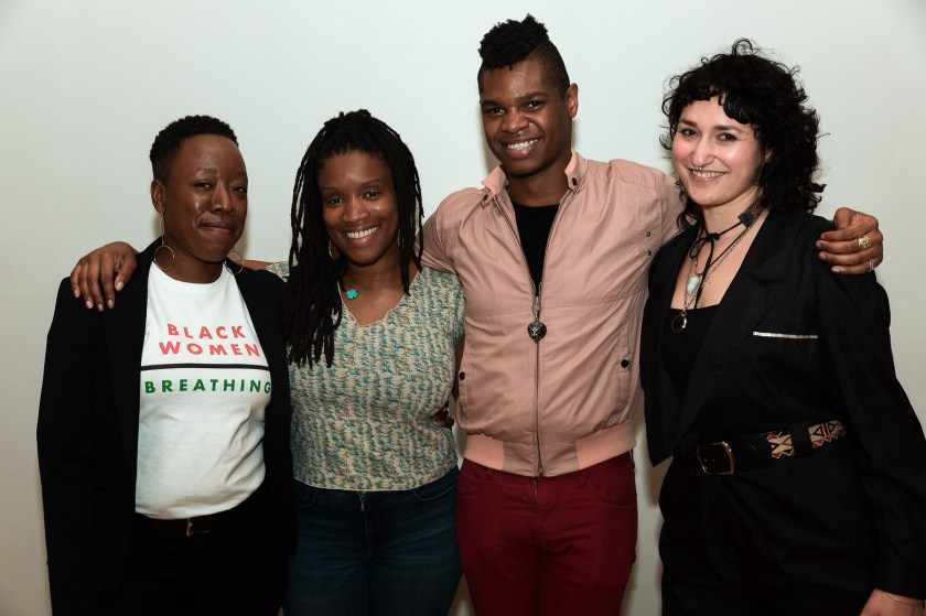 "Image: Regina Martinez with Threewalls colleagues. Dr. Jeffreen M. Hayes, Lauren Williams, Omar Dyette, and Martinez (from left to right) stand with arms around each other, posing for the camera. Hayes wears a black jacket open over a white t-shirt that reads ""Black Women 