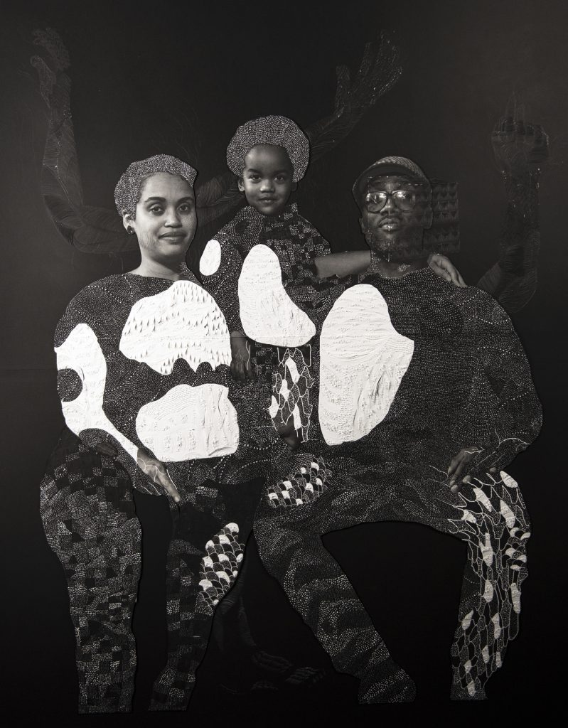 """Image: Nate Lewis, """"Sankofa,"""" 2018. A photo collage. A family is seated and looks out at the viewer. A woman is on the left, a man on the right, and a child in the middle. The image is black and white. The paper is textured to create patterns in the place of their clothes. In the background, three arms that are delicately textured and patterned reach up toward the top of the image. Image courtesy of Smithsonian Institution Traveling Exhibition Service and the artist."""