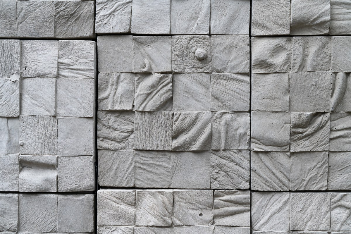 Featured image: Selva Aparicio, Entre Nosotros (Among Us) Detail, 2020. Concrete tiles cast from human cadavers. The images show a close up of the piece, showing details of a grid of square, concrete blocks. Each block has different folds, and one shows a nipple, all cast from human parts. Photo by Robert Chase Heishman. Image courtesy of the artist.