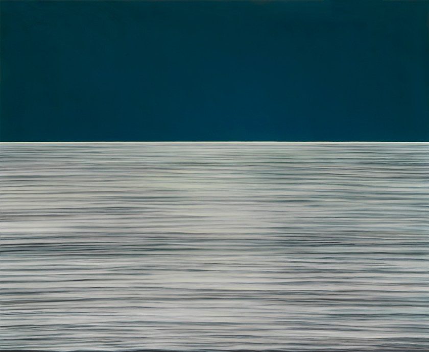 """Image: Moon Translation #635, oil on panel, 55"""" x 67"""", 2020. The lower half of the image is a grey hue with harsh, flat lines that are darker, almost black. Above the water is a flat color with no detail. It's a dark blue. Photo by Tom Van Eynde."""