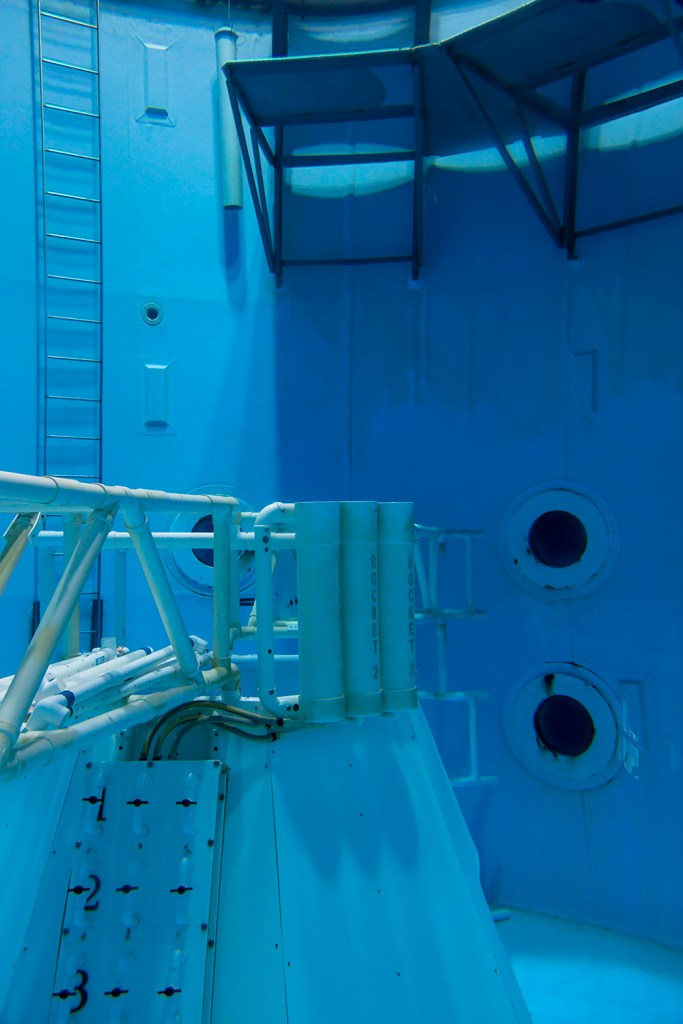 Image: Neutral Buoyancy Simulator, 2019 by Barbara Diener. The image shows a neutral buoyancy simulator tank at the U.S. Space and Rocket Center in Huntsville, AL. The tank is completely blue (various shades). Image courtesy of the artist.
