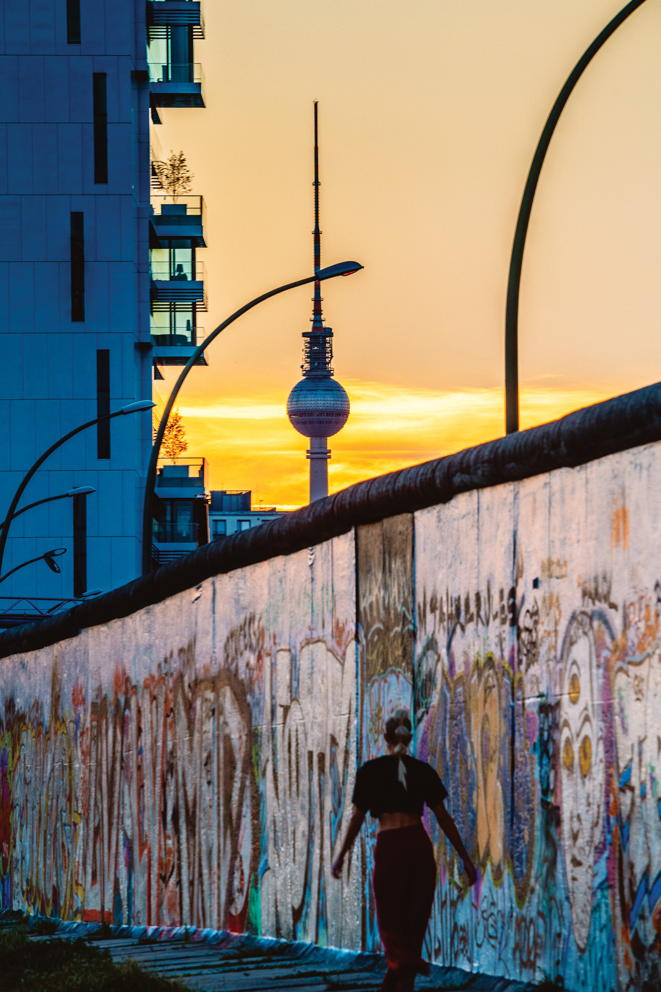 sixtysix mag on the road berlin wall sunset