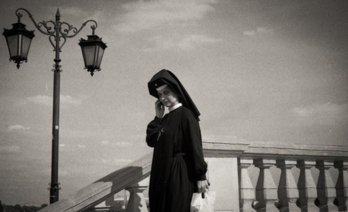 Nun talking on the phone