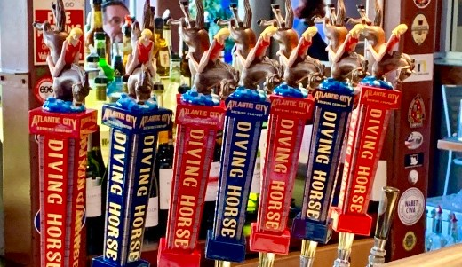 The taps at the Tun Tavern in Atlantic City featuring their Diving Horse line of craft beers