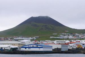 Heimaey, volcano Eldfell over port Vestmannaeyjar, South Iceland
