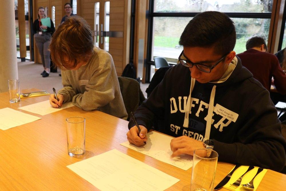 Pupils work through the MAT questions with current Maths undergrads.
