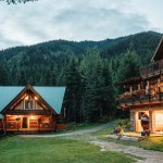 wedding venue, cabins with wood mountain background