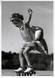 Little girl skater with pillow - history of roller skating