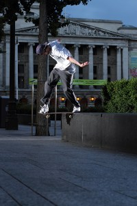 Dave Wallace executing a switch backside tailside at Old Market Square, Nottingham. Photo by Tom Quigley