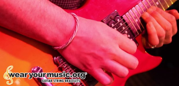 Company uses guitar strings to raise money for charity