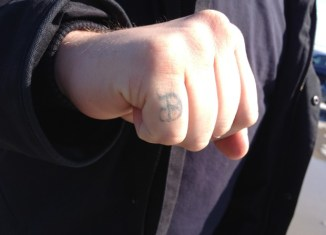 A close up of a knuckle tattoo.