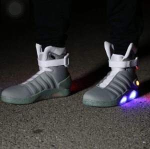 A pair of light up grey and white shoes.