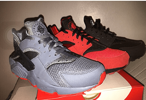 Three right side shoes. A grey, red and black.