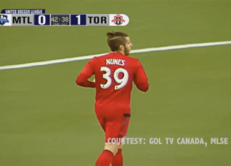 "The back of a Toronto FC soccer players jersey that reads ""Nunes 39"""