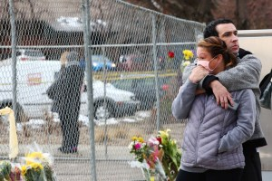 People embrace each other at the site of a mass shooting. March 23, 2021.
