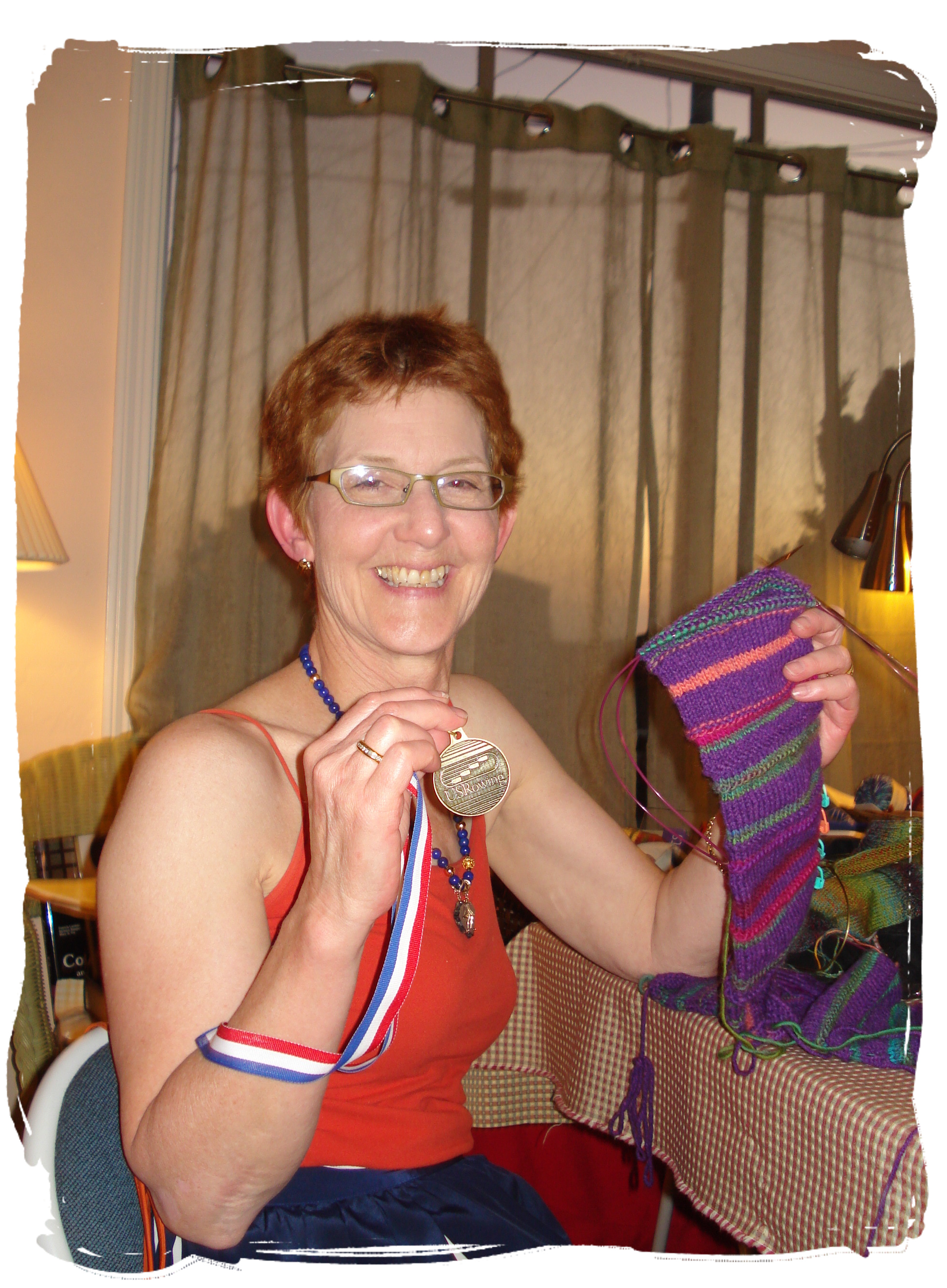 Peg with her medal and knitting