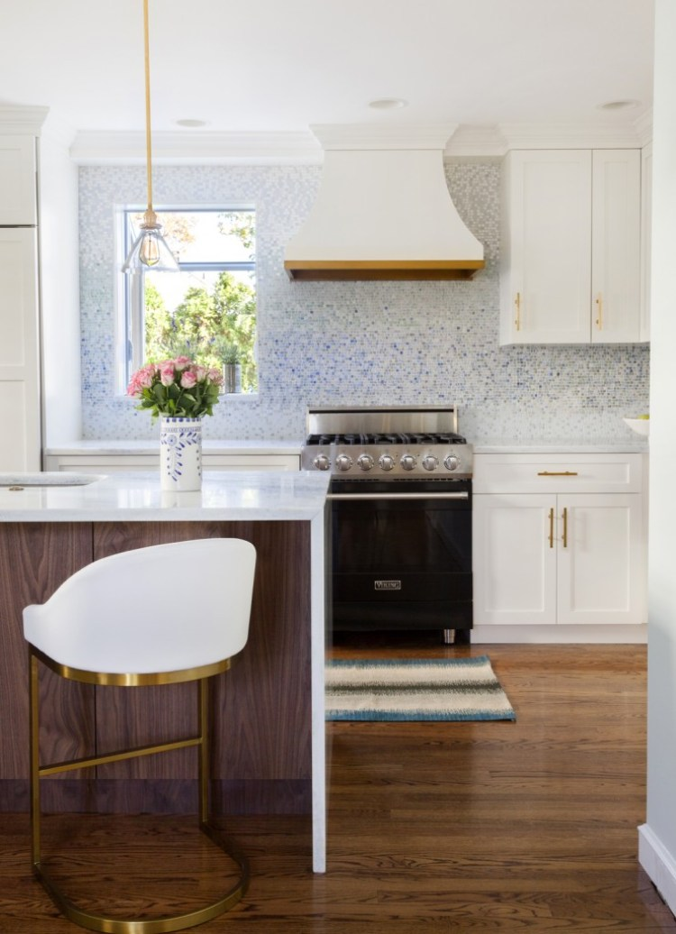 Design-Manifest-Kitchen-Waterfall-island-Curved-white-and-brass-hood-741x1024