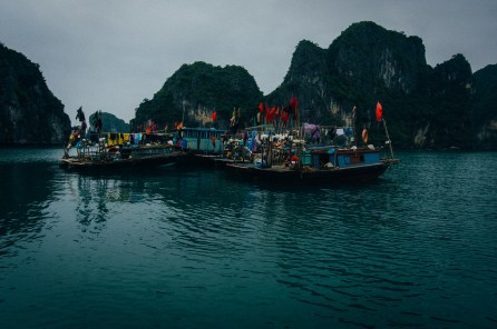 While being in Ha Long Bay we had the only days within our almost 5 weeks with rain and foggy weather. So it was a very mystic scenery all along the rocks which emerge in front of our boat. But still there are those colorful moments even in this sinister surrounding. Fishermen and their boats loitering around waiting for their next catch. (Ha Long Bay, Vietnam)