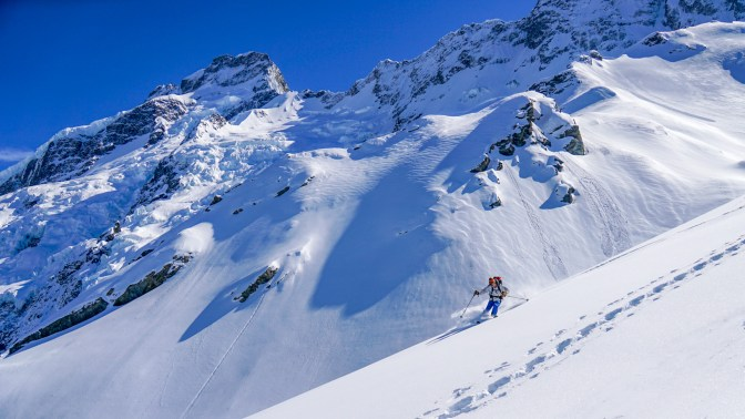 Hans skiing great recrystallised pow under Sefton Bivouac. Mount Sefton in the background.